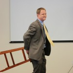 Kevin Strong Speaking using chair